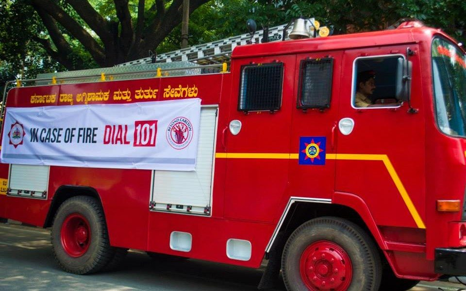 Dial 101 in case of fire.  It would be a better idea though if you take the necessary precautions to prevent fire in the first place.